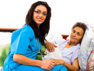 elderly woman with her young caregiver