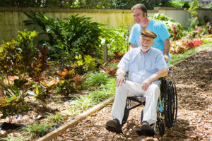 disabled senior man and his caregiver